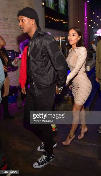 Lou Williams and Rece Mitchell attend a Party at Empire on April 16 2018 in Atlanta Georgia
