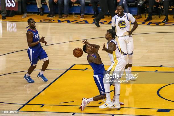 Lou Williams of LA Clippers in action against Nick Young of Golden State Warriors during the NBA basketball game between LA Clippers and Golden State...