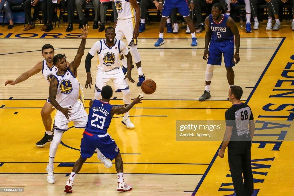 Lou Williams (23) of LA Clippers in action against Nick Young (6) of Golden State Warriors during the NBA basketball game between LA Clippers and Golden State Warriors at Oracle Arena in Oakland, United States on January 10, 2018.