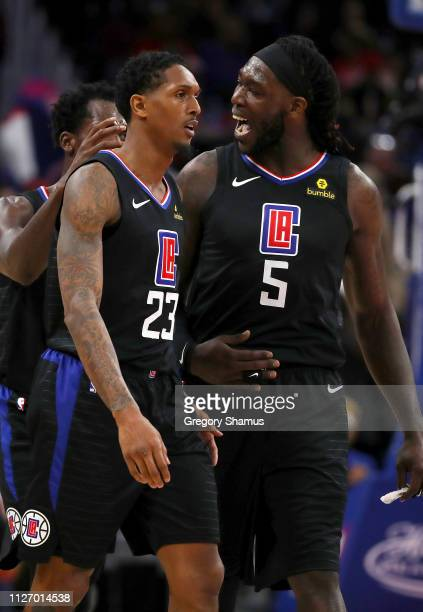 Lou Williams of the LA Clippers celebrates a second half basket with Montrezl Harrell while playing the Detroit Pistons at Little Caesars Arena on...