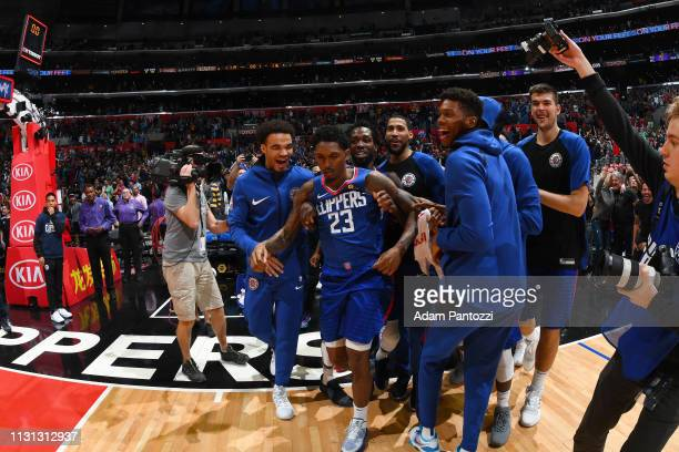 Lou Williams of the LA Clippers celebrates with his team after scoring a gamewinner against the Brooklyn Nets on March 17 2019 at STAPLES Center in...