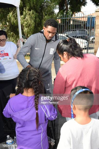 Lou Williams of the LA Clippers distributes food and personal care items on October 13 2018 at the Salvation Army Siemon Family Youth Community...