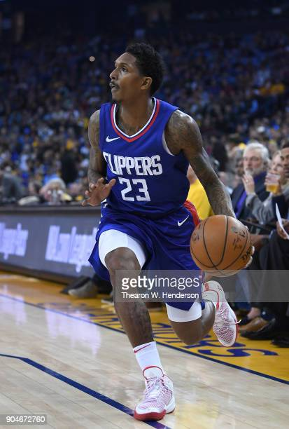 Lou Williams of the LA Clippers dribbles the ball against the Golden State Warriors during the first half of their NBA Basketball game at ORACLE...
