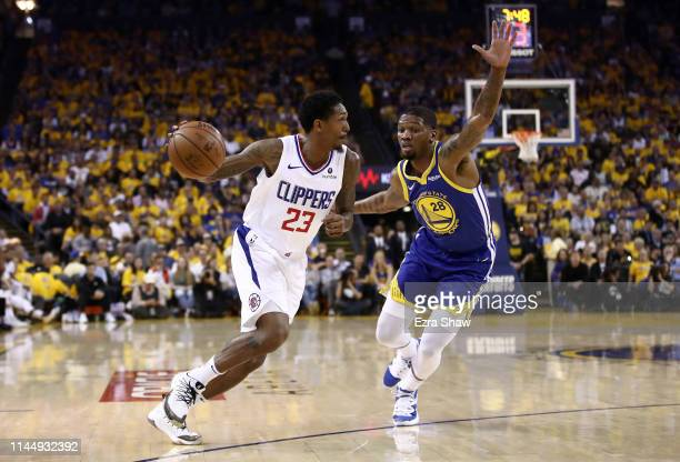 Lou Williams of the LA Clippers drives on Alfonzo McKinnie of the Golden State Warriors during Game Five of the first round of the 2019 NBA Western...