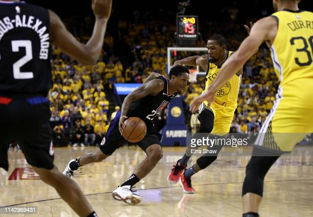 Lou Williams of the LA Clippers drives on Kevin Durant of the Golden State Warriors during Game Two of the first round of the 2019 NBA Western...