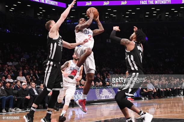 Lou Williams of the LA Clippers drives to the basket against D'Angelo Russell and Nik Stauskas of the Brooklyn Nets during the game at Barclays...