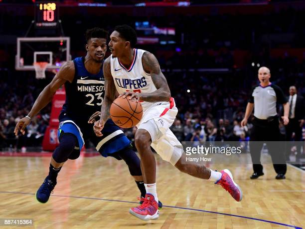 Lou Williams of the LA Clippers drives to the basket on Jimmy Butler of the Minnesota Timberwolves during a 113107 Timberwolves win at Staples Center...