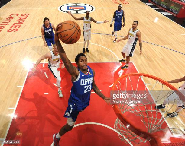 Lou Williams of the LA Clippers dunks against the Denver Nuggets on April 7 2018 at STAPLES Center in Los Angeles California NOTE TO USER User...