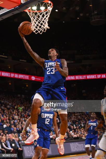 Lou Williams of the LA Clippers goes to the basket against the Golden State Warriors on January 10 2018 at ORACLE Arena in Oakland California NOTE TO...