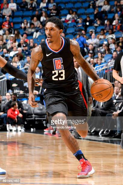 Lou Williams of the LA Clippers handles the ball against the Orlando Magic on December 13 2017 at Amway Center in Orlando Florida NOTE TO USER User...
