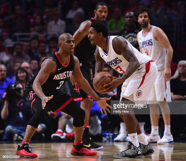 Lou Williams of the LA Clippers hangs on to the ball as he is guarded by Chris Paul of the Houston Rockets during the first half at Staples Center on...