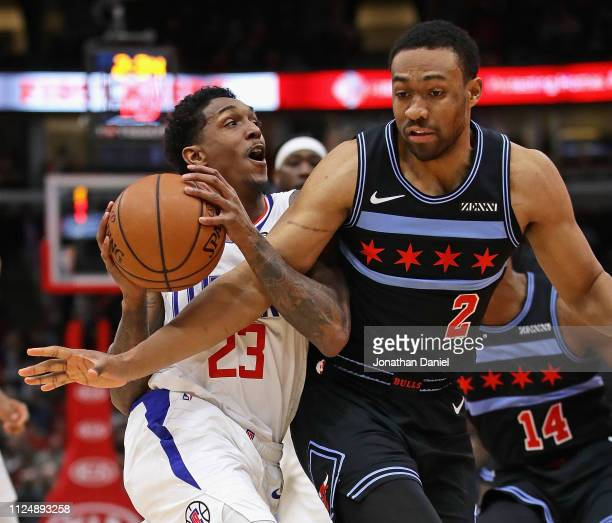 Lou Williams of the LA Clippers is fouled by Jabari Parker of the Chicago Bulls at the United Center on January 25 2019 in Chicago Illinois NOTE TO...