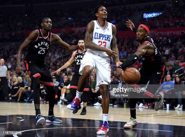 Lou Williams of the LA Clippers is stripped of the ball by Rondae HollisJefferson of the Toronto Raptors between Mfiondu Kabengele during the first...