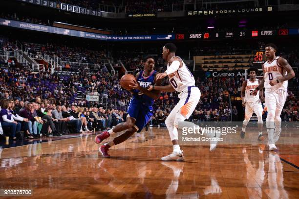 Lou Williams of the LA Clippers jocks for a position during the game against the Phoenix Suns on February 23 2018 at Talking Stick Resort Arena in...