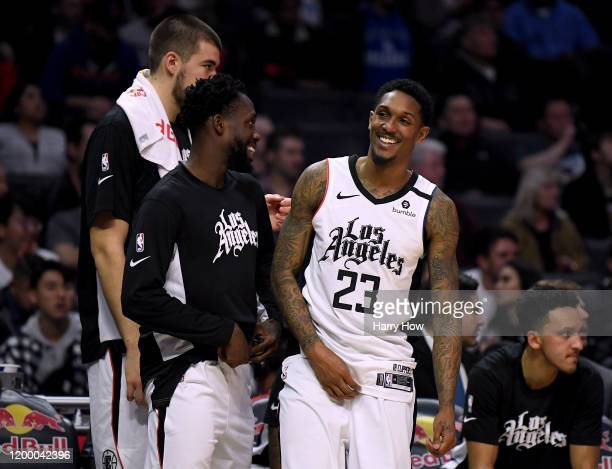 Lou Williams of the LA Clippers laughs with Patrick Beverley during a 122-95 Clipper win over the Orlando Magic at Staples Center on January 16, 2020...