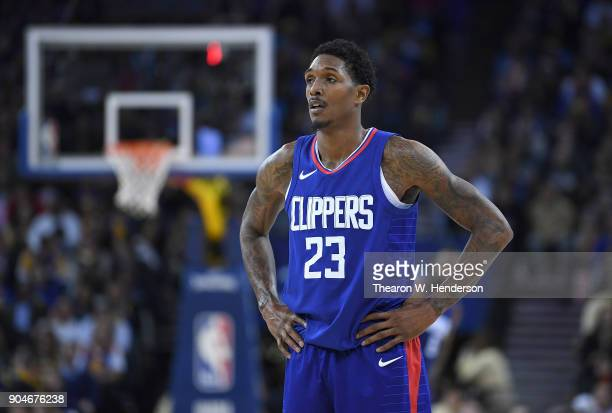 Lou Williams of the LA Clippers looks on against the Golden State Warriors during the first half of their NBA Basketball game at ORACLE Arena on...