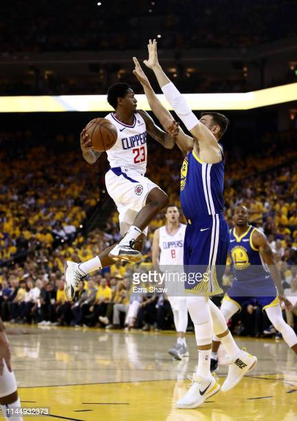 Lou Williams of the LA Clippers looks to pass around Andrew Bogut of the Golden State Warriors during Game Five of the first round of the 2019 NBA...