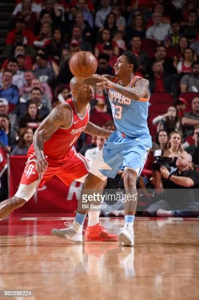 Lou Williams of the LA Clippers passes the ball against the Houston Rockets on March 15 2018 at the Toyota Center in Houston Texas NOTE TO USER User...