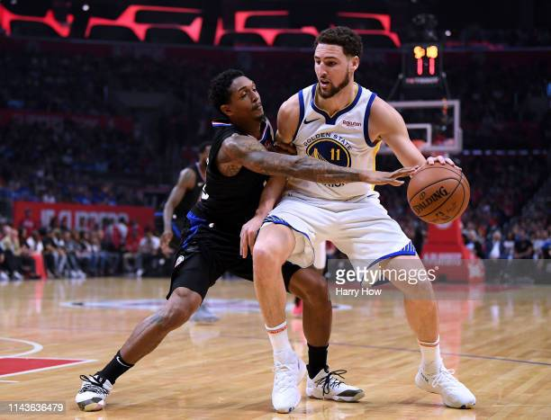 Lou Williams of the LA Clippers reaches in as he guards Klay Thompson of the Golden State Warriors during Game Two of Round One of the 2019 NBA...