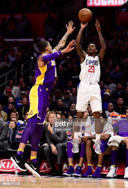 Lou Williams of the LA Clippers scores on a three pointer over Kyle Kuzma of the Los Angeles Lakers during the second quarter in a 120115 Clipper win...