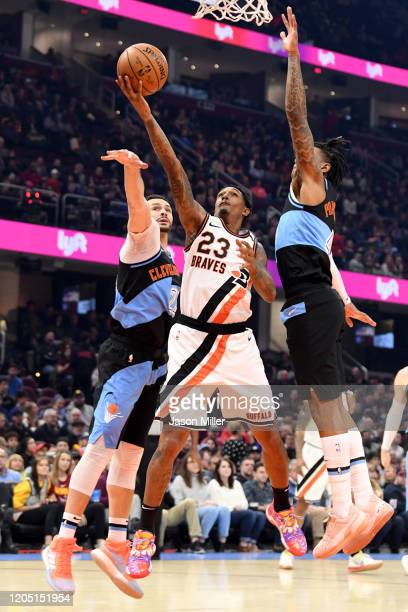Lou Williams of the LA Clippers shoot over Larry Nance Jr. #22 and Kevin Porter Jr. #4 of the Cleveland Cavaliers prior to the game against the LA...