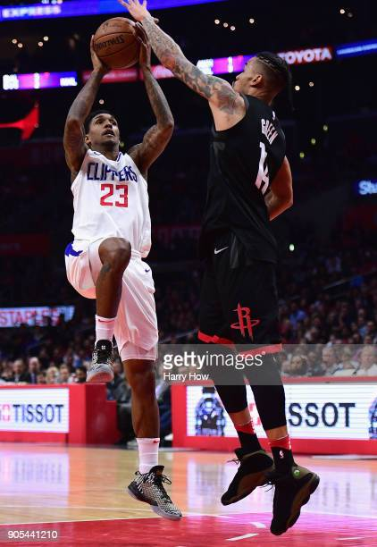 Lou Williams of the LA Clippers shoots a fadeaway jumper over Gerald Green of the Houston Rockets during a 113102 Clipper win at Staples Center on...