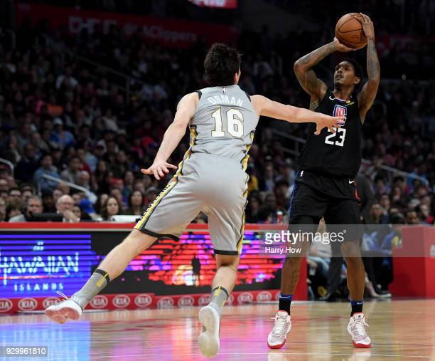 Lou Williams of the LA Clippers shoots a jumper over Cedi Osman of the Cleveland Cavaliers during a 116102 Clipper win at Staples Center on March 9...