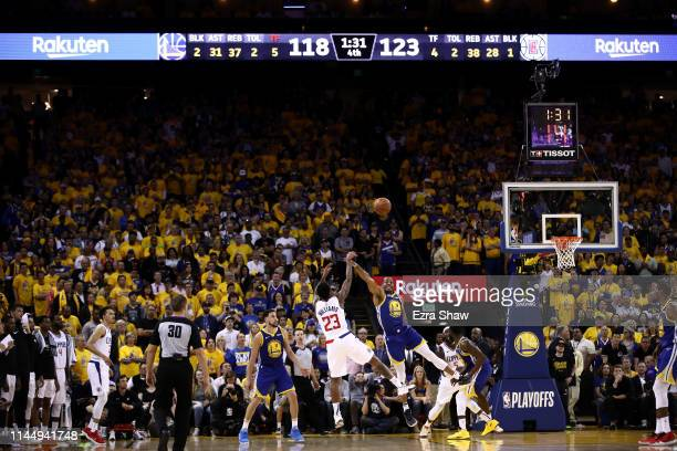 Lou Williams of the LA Clippers shoots over Andre Iguodala of the Golden State Warriors during Game Five of the first round of the 2019 NBA Western...