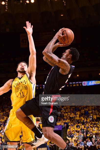 Lou Williams of the LA Clippers shoots the ball against Klay Thompson of the Golden State Warriors during Game Two of Round One of the 2019 NBA...