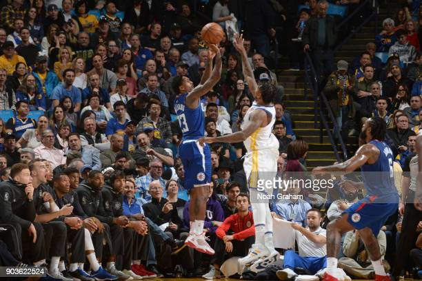 Lou Williams of the LA Clippers shoots the ball against the Golden State Warriors on January 10 2018 at ORACLE Arena in Oakland California NOTE TO...