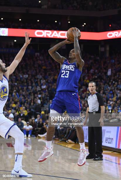 Lou Williams of the LA Clippers shoots the ball over Omri Casspi of the Golden State Warriors during the first half of their NBA Basketball game at...