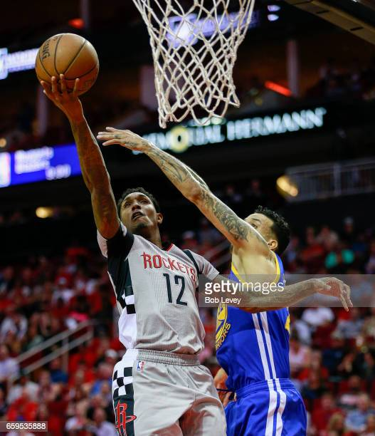 Lou Williams of the Houston Rockets drives past Matt Barnes of the Golden State Warriors during the first quarter at Toyota Center on March 28 2017...