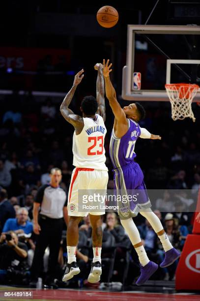 Lou Williams of the Los Angeles Clippers attempts a jump shot against Garrett Temple of the Sacramento Kings on October 12 2017 at STAPLES Center in...