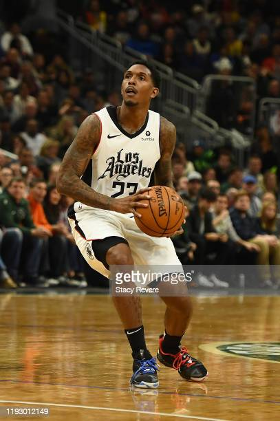 Lou Williams of the Los Angeles Clippers handles the ball during a game against the Milwaukee Bucks at Fiserv Forum on December 06 2019 in Milwaukee...