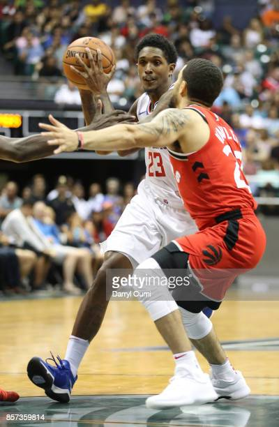 Lou Williams of the Los Angeles Clippers looks to get past Fred VanVleet of the Toronto Raptors during the third quarter at the Stan Sheriff Center...