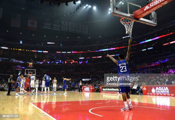 Lou Williams of the Los Angeles Clippers points before a tip off against Sacramento Kings during the first half at Staples Center on January 13 2018...