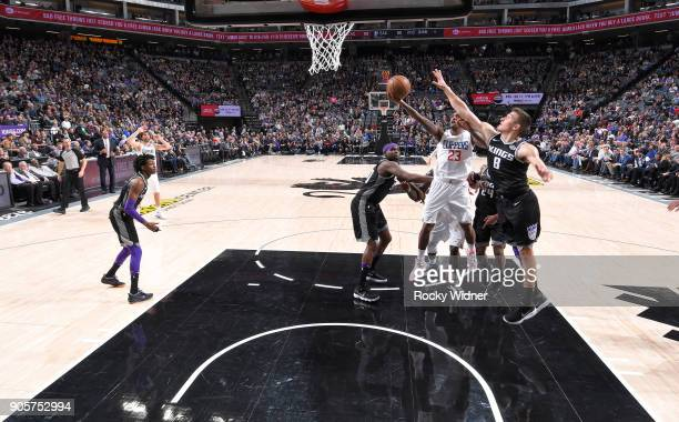 Lou Williams of the Los Angeles Clippers shoots a layup against Bogdan Bogdanovic of the Sacramento Kings on January 11 2018 at Golden 1 Center in...