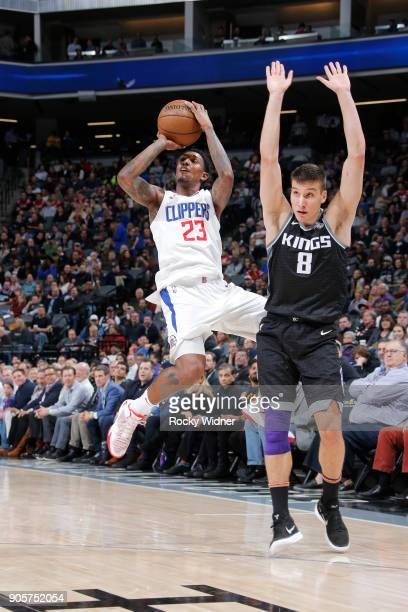 Lou Williams of the Los Angeles Clippers shoots against Bogdan Bogdanovic of the Sacramento Kings on January 11 2018 at Golden 1 Center in Sacramento...