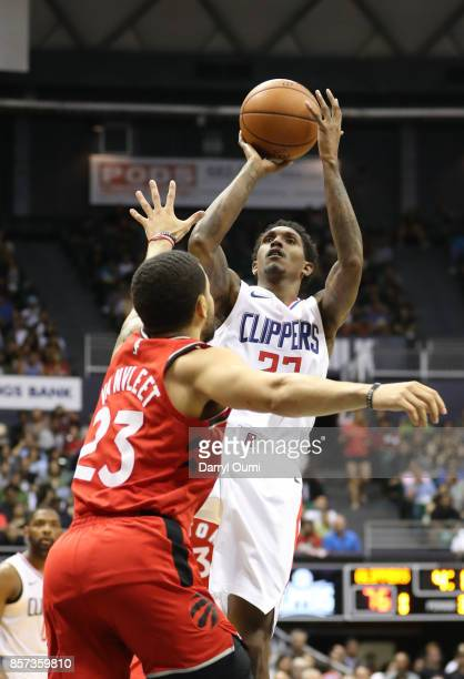 Lou Williams of the Los Angeles Clippers takes a fade away jump shot over Fred VanVleet of the Toronto Raptors during the third quarter at the Stan...