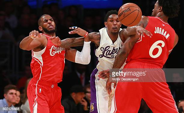 Lou Williams of the Los Angeles Lakers pursues the ball between Chris Paul and DeAndre Jordan of the Los Angeles Clippers in the second half of their...