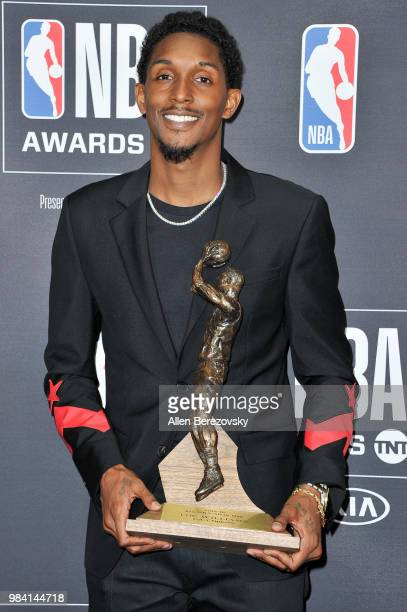 Lou Williams winner of the 20172018 6th Man Award poses in the backstage photo room during the 2018 NBA Awards Show at Barker Hangar on June 25 2018...