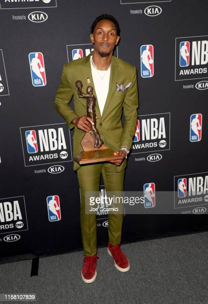 Lou Williams, winner of the Kia NBA Sixth Man of the Year Award, poses in the press room during the 2019 NBA Awards presented by Kia on TNT at Barker...