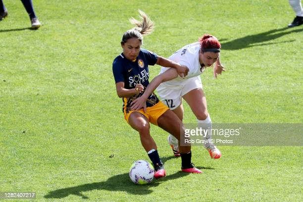 "Lo""u2019eau LaBonta of Utah Royals FC and Morgan Andrews of OL Reign FC battle for the ball during a game between OL Reign and Utah Royals FC at Rio..."