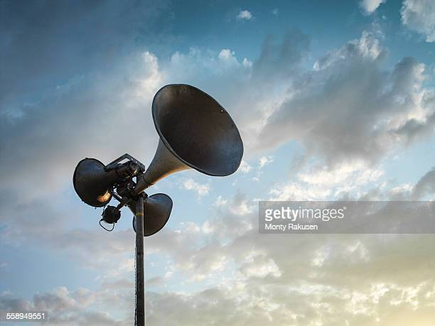loud speaker against sky - megaphone stock pictures, royalty-free photos & images