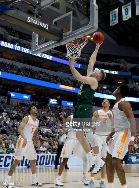 Loudon Love of the Wright State Raiders shoots the ball under the basket in the second half against the Tennessee Volunteers in the first round of...