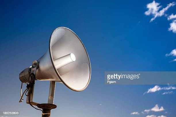Loudspeakers broadcast a message