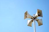 loudspeakers mounted on pole