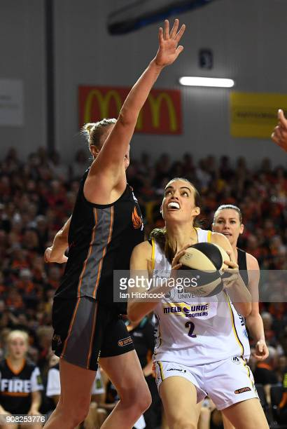 Louella Tomlinson of the Boomers drives to the basket past Suzy Batkovic of the Fire during game three of the WNBL Grand Final series between the...