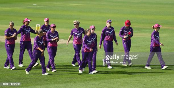 Loughborough Lightning walk off the pitch after their innings during the Kia Super League match between Loughborough Lightning and Surrey Stars at...