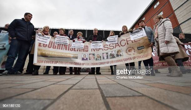 Loughinisland victim family members stand with a banner outside Belfast High Court on January 12 2018 in Belfast Northern Ireland The judge has...